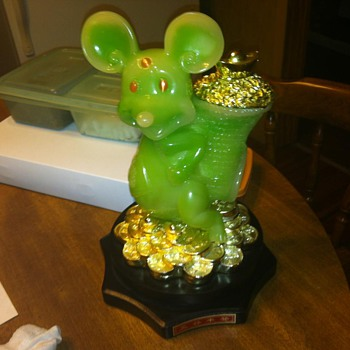 green Mickey mouse on pedestal