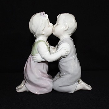 Boy girl  kissing figurine