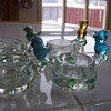 vintage bird topped egg cups with green bubbles