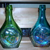Two carnival glass bottles.