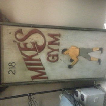 Antique hand painted two sided wooden signs, not sure of its history and how old it is