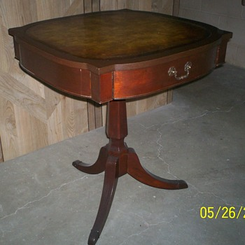 table with leather top, center drawer