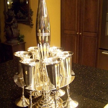 6 silver plated Champagne Flute holder.