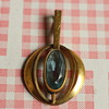 AM. DBL A*D Gold tone and aquamarine pendant
