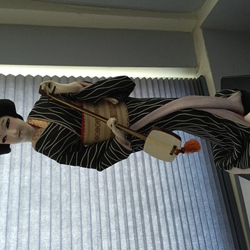 Japanese Geisha doll with stringed instrument