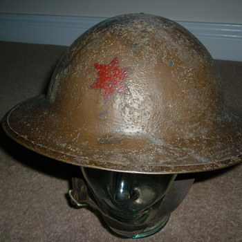 WW1 British made steel helmet with Brodie stamp in the liner.