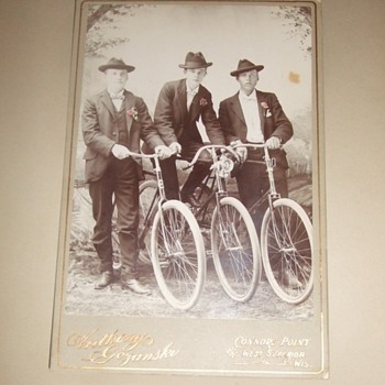 Cabinet card of three Wisconsin bicycle riders c. 1890s - Photographs