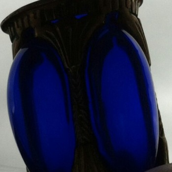 Cobalt blue glass and brass/bronze framework vase