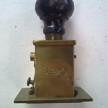 Brass stamper.