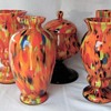 The Ruckl Interwar Era Glass Collection - the multi colored spatter pieces in orange