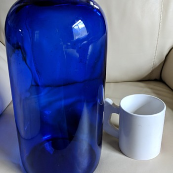 Cobalt blue over 7 liter bottle marked M in circle. What was it for? - Bottles