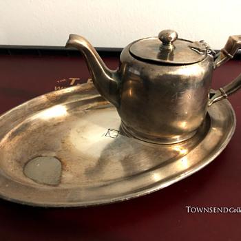 "The T. EATON Co. Limited, Winnipeg Diamond ""E"" Saucer and Tea Pot circa. 1905   - Silver"