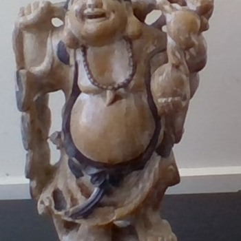 Lucky laughing buddha stone carving
