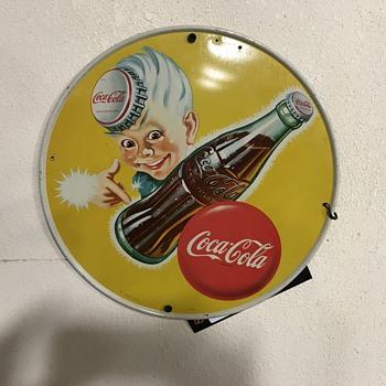 two Coca Cola sprite boy signs  - Advertising