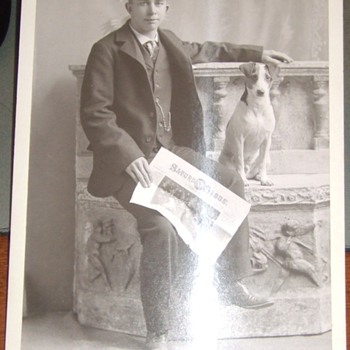 Cabinet card of man with dog and newspaper - Photographs