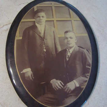 portrait photograph two african american men on metal