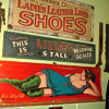 Vintage pub woman signage and wardrobe dealer sign.