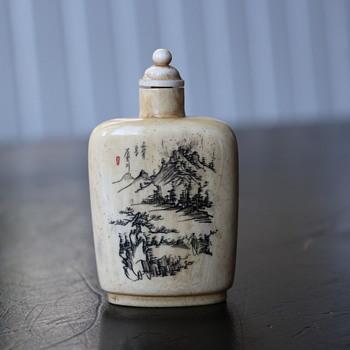 Ivory carved snuff bottle