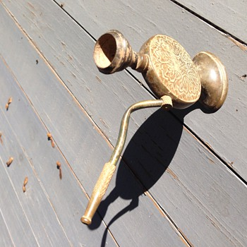 Antique brass opium pipe?