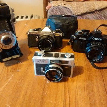 A Sunday Boot sale find, Camera collection 2 SLR's,  Kodak Sterling Fold up, one compact and an APS