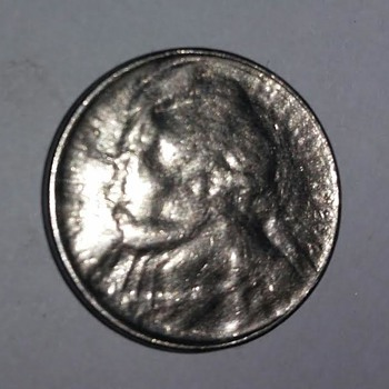 Jefferson Nickel Multiple strike through grease obverse