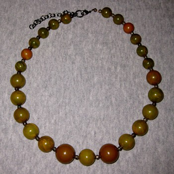 A mix of swirly green bakelite beads redone as a necklace - Costume Jewelry