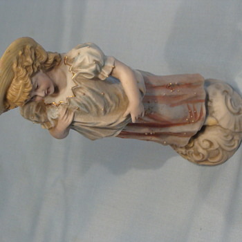 Antique plaster-cast girl figurine