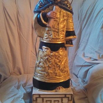 Oriental Figurine Lamp. No one knows what  it is.
