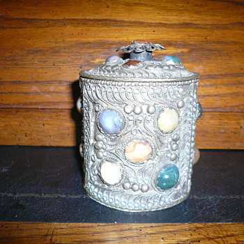 metal can with stones on and a lid