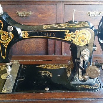 Antique National Unity Treadle sewing machine and cabinet