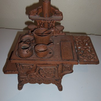 Cast iron(?) stove with pots and pans