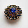 Blue sunburst brooch