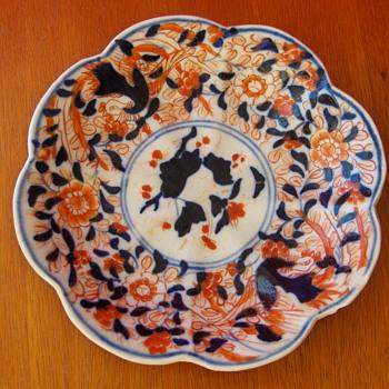 An antique Japanese Imari platter, gosu blue under glaze, red hand painted motifs over glaze, not marked. - Asian