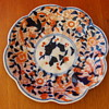 An antique Japanese Imari platter, gosu blue under glaze, red hand painted motifs over glaze, not marked.