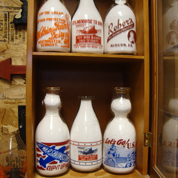 Another small case filled with duplicate milk bottles........ - Bottles