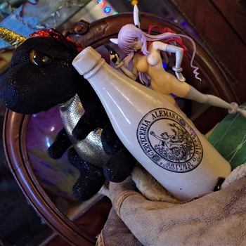 risque pictorial stoneware beverage bottle antique bueno saires  1899 year plus a glimpse of me bed in the sky - Breweriana