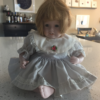 Cloth Body, Sitting Doll, Sewn on Head full legs and arms.