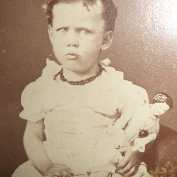 CDV of child with China Head doll