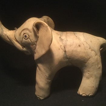 I love elephants, and this strange piece came my way - Figurines