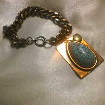 Copper link bracelet with large charm