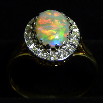 Bright Crystal Opal Ring with a Halo of Diamonds - Fine Jewelry