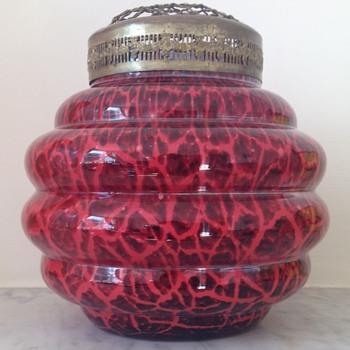 Giraffe urn with a deep red ground. - Art Glass