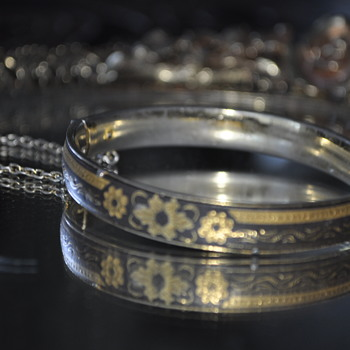 vintage bracelet - secured lock with black material and gold flowers.  - Costume Jewelry