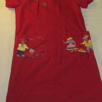 hand made dress with pictorial embroidery