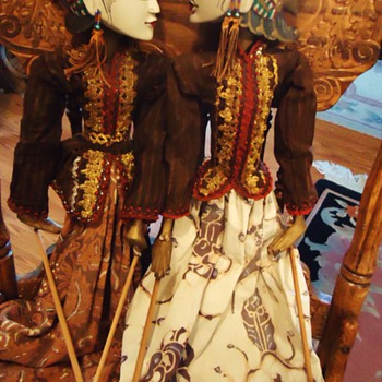 2 Maybe Indonesian wood puppets with nice bead earrings!