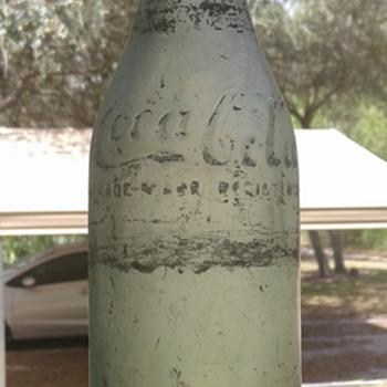 Straight side Coca-Cola bottle