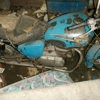 My dad traded an old triumph for this and was told it was one of only 50 or in the states, would love to get it running someday - Motorcycles