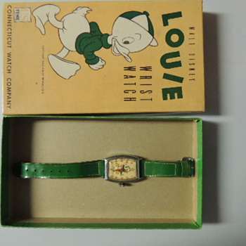 1947 SNOW WHITE and LOUIE WATCHES - Wristwatches