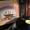 All along he's playing the fiddle,  strumming his Diddle
