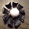 Vintage Brooch - Can't read print on the petal.